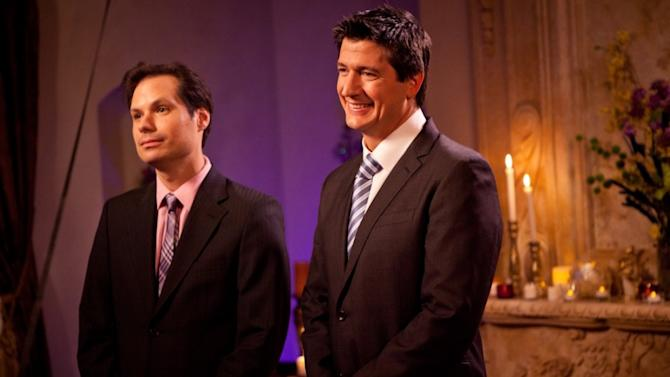 """This undated image released by Paramount Pictures shows actors, Michael Ian Black as host, and Ken Marino in a scene from the Yahoo Web series """"Burning Love,"""" a spoof of the popular romance reality series, """"The Bachelor."""" (AP Photo/Paramount Pictures)"""
