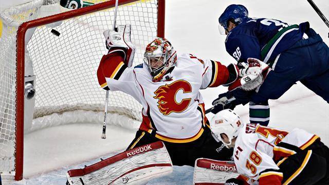 NHL - Canucks rally from slow to start to extinguish Flames