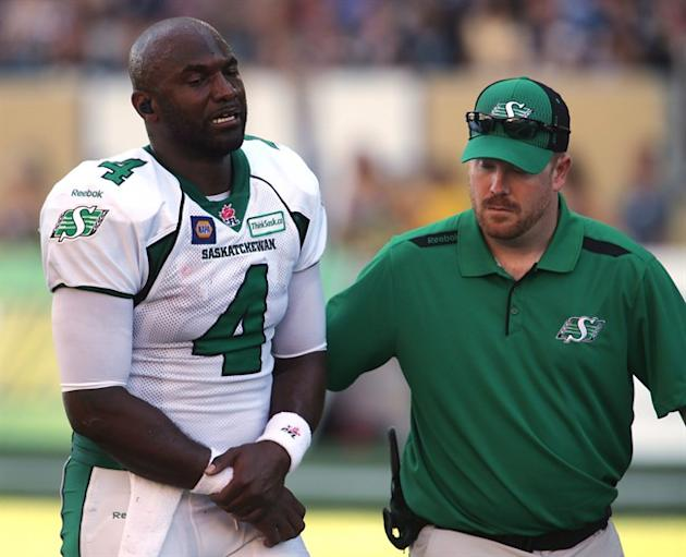 Saskatchewan Roughriders' Darian Durant (4) leaves the field after getting hurt during a play against the Winnipeg Blue Bombers' during second half CFL football action at Investors Group Field