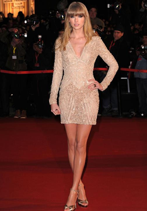 Taylor Swift was sizzling in this sequin nude mini dress at the NRJ Music Awards ©Rex