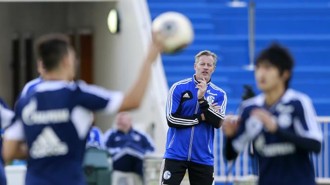 Schalke 04's coach Jens Keller follows his team's training session at the Aspire Academy of Sports Excellence in Doha