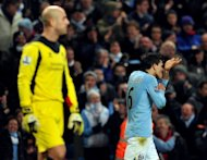Sergio Aguero (R) celebrates after beating Pepe Reina to equalise 2-2 for Manchester City against Liverpool at the Etihardtoday