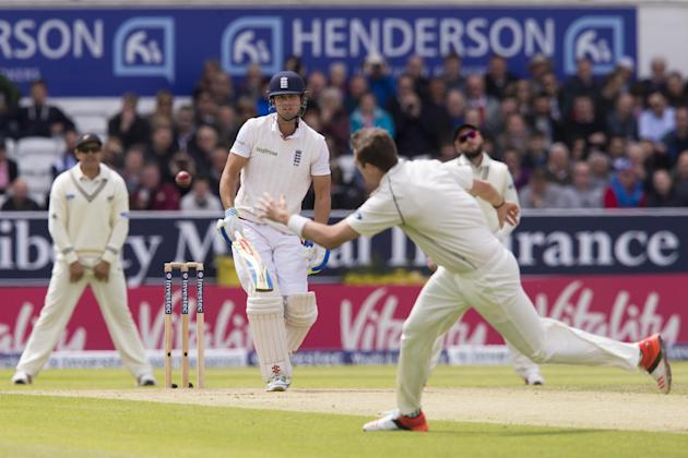 England's captain Alastair Cook, centre left, looks on as New Zealand's Tim Southee, centre right, fields off his own bowling on the second day of the shot off the bowling of second Test match