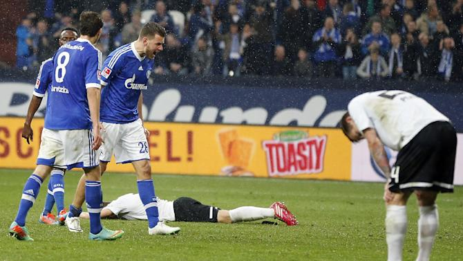 Schalke's Adam Szalai of Hungary, third from left,  celebrates after scoring during the German first division Bundesliga soccer match between Schalke 04 and Eintracht Braunschweig in Gelsenkirchen, Germany, Saturday, March 22, 2014