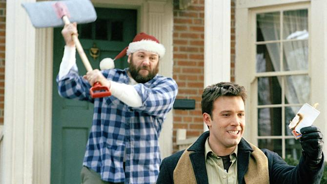 """FILE - This file publicity image provided by Dreamworks shows James Gandolfini, as Tom Valco, left, and Ben Affleck, as Drew Latham, in DreamWorks Pictures comedy """"Surviving Christmas."""" Gandolfini, whose portrayal of a brutal, emotionally delicate mob boss in HBO's """"The Sopranos"""" helped create one of TV's greatest drama series and turned the mobster stereotype on its head, died Wednesday, June 19, 2013 in Italy. He was 51.  (AP Photo/Dreamworks, Susanne Tenner, File)"""