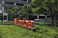 Chinese workers walk out of the Alibaba head office building in Hangzhou, in eastern China's Zhejiang province on May 21, 2012. As Alibaba chief Jack Ma steps aside after building the world's largest online retailer, the Chinese firm is preparing a huge stock offer prompting comparisons with Facebook -- whose profits it dwarfs