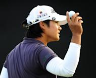 Yani Tseng of Taiwan celebrates par on the 18th hole during the third round of the Kia Classic at the La Costa Resort and Spa March 24, in Carlsbad, California. Tseng fired a three-under 69 to seize a three-shot lead