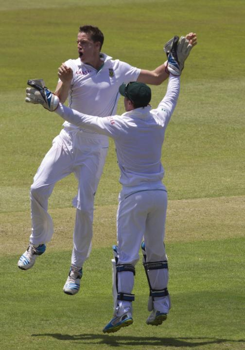 South Africa's Morkel and de Villiers celebrate the wicket of India's Dhawan during the first day of the second cricket test match in Durban