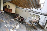 A destroyed house with furniture still intact inside is seen in Jamestown, Colorado, after a flash flood destroyed much of the town, September 14, 2013. REUTERS/Rick Wilking