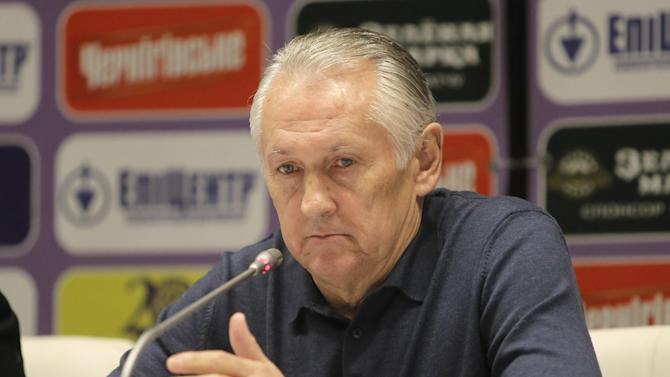 Ukraine's  national soccer coach Mikhail Fomenko attends a news conference at the Olympiyskiy national stadium in Kiev, Ukraine, Thursday, Nov. 14, 2013, ahead of their 2014 World Cup qualifying  playoff soccer match against France
