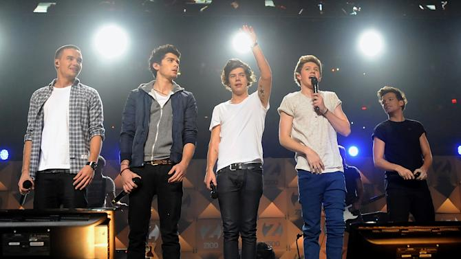 FILE - In this Dec. 7, 2012 file photo, members of One Direction, from left, Liam Payne, Zayn Malik, Harry Styles, Niall Horan, and Louis Tomlinson perform at Z100's Jingle Ball 2012  in New York. It's a crowded tour market and everyone is competing for your entertainment dollar. (Photo by Evan Agostini/Invision/AP, file)