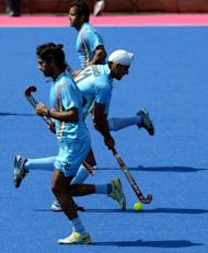 Members of the Indian men's field hockey team take part in a training session at the Old Loughtonians Hockey Club at Chigwell in Essex on July 26, 2012. Eight-time champions India return to Olympic Games hockey, having failed to qualify for Beijing four years ago, although, given the last of their gold medals came back in 1980, they are not expected to be on the podium in London