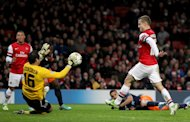 Jack Wilshere, right, opened the scoring for the Gunners