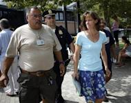 Hoboken Mayor Dawn Zimmer (R) walks with rescue officials near the site of a crash between a helicopter and an airplane over the Hudson River, in Hoboken, New Jersey, August 8, 2009. REUTERS/Eric Thayer