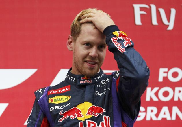Red Bull Formula One driver Vettel gestures on the podium after winning the Korean F1 Grand Prix in Yeongam
