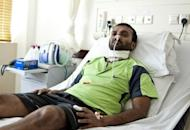 Maldivian journalist and blogger Ismail Rasheed recovers in a hospital bed on June 16 after being attacked in Male, the capital of the Maldives. Rasheed, who nearly died in the attack, has blamed resurgent Islamists for the assault and fled the country. AFP PHOTO/Ali NISHAN