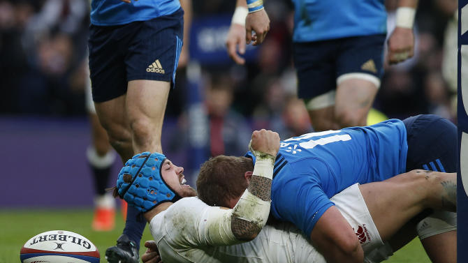 England's Jack Nowell celebrates as he scores a try during the Six Nations rugby union match between England and Italy at Twickenham stadium in London, Sunday, Feb. 26, 2017. (AP Photo/Alastair Grant)