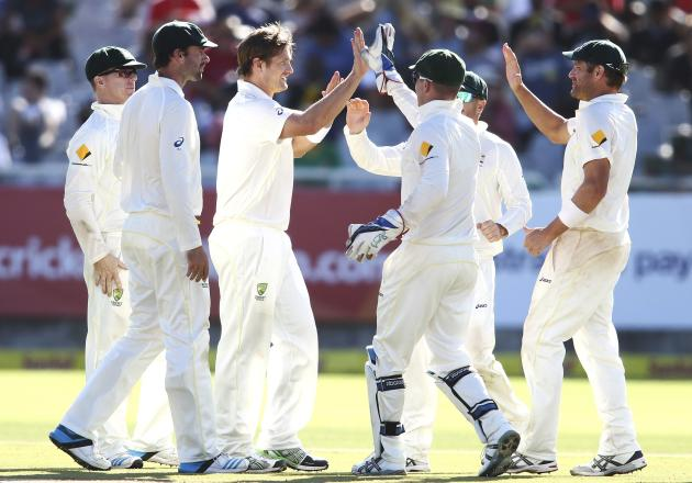 Australia's Watson celebrates the wicket of Abbott with team mates during the third day of the third cricket test match against South Africa at Newlands Stadium in Cape Town