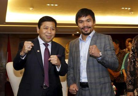 Filipino boxing superstar Manny Pacquiao poses with the head of Indonesia's House of Representatives (DPR) Setya Novanto during a courtesy call in Jakarta Indonesia