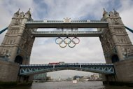 "The 2012 Olympic rings are unveiled on London's Tower Bridge in June 2012. Shoddy management and a lack of funds look set to condemn Southeast Asia to yet another dismal Olympics, with one expert warning the region's sport even faces ""collapse"" without a drastic re-think"