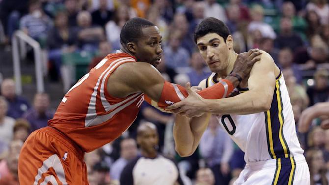 Houston Rockets' Dwight Howard, left, and Utah Jazz's Enes Kanter (0) battle for position under the boards in the second half during an NBA basketball game Saturday, Nov. 2, 2013, in Salt Lake City. The Rockets defeated the Jazz 104-93