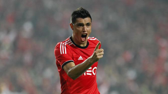 Benfica's Oscar Cardozo, from Paraguay celebrates after scoring his second goal against Sporting during a Portugal Cup soccer match between Benfica and Sporting at Benfica's Luz stadium in Lisbon, Saturday, Nov. 9, 2013. Cardozo scored a hat-trick in Benfica's 4-3 victory