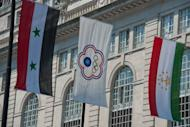 The flag of the Chinese Taipei Olympic Committee (C), replacing the national flag of Taiwan, hangs in a display of flags for the London 2012 Olympic Games over Regent Street in central London