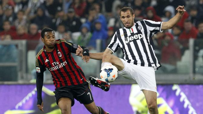 Juventus' Chiellini is challenged by AC Milan's Robinho during their Italian Serie A soccer match in Turin