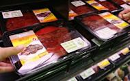 A customer picks up a package of kangaroo steak from the meat section of a supermarket in central Sydney September 9, 2008. REUTERS/Daniel Munoz