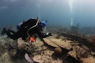 A NOAA diver taking notes above the wreck of the Hannah M. Bell in September, 2012, off the coast of Key Largo, Fla.