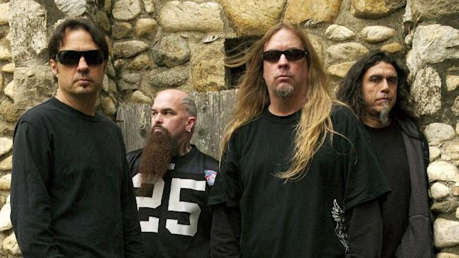 This 2009 publicity photo provided courtesy of Slayer shows, from left, Dave Lombardo, Kerry King, Jeff Hanneman and Tom Araya. Hanneman, 49, died May 2, 2013, of liver failure at a Los Angeles hospital with his wife, Kathy, by his side. It was initially theorized that Hanneman's death might have had something to do with a suspected spider bite that led to a case of necrotizing fasciitis, nearly costing him his arm. Members of Slayer say Hanneman died of alcohol-related cirrhosis. (AP Photo/Courtesy of Slayer, Mark Seliger)