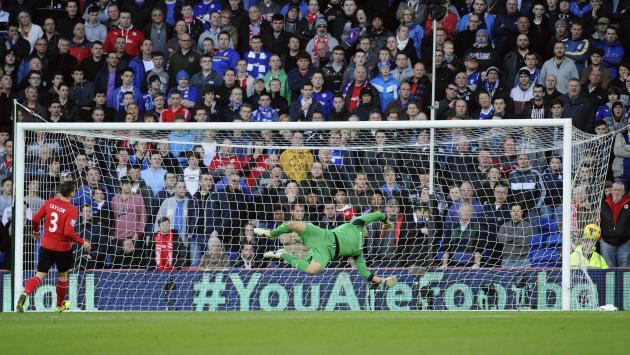 Cardiff City's goalkeeper David Marshall fails to stop a goal being scored by Arsenal's Aaron Ramsey during their English Premier League soccer match at Cardiff City Stadium in Cardiff