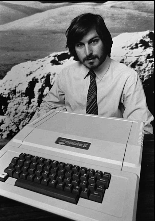 FILE - This 1977 file photo shows Apple co-founder Steve Jobs as he introduces the new Apple II in Cupertino, Calif. Apple on Wednesday, Oct. 5, 2011 said Jobs has died. He was 56. (AP Photo/Apple Com