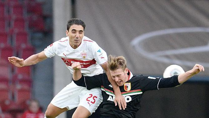 Stuttgart's  Mohammed Abdellaoe. left, challenges for the ball with Augsburg's Jan Callsen-Bracker  during the German first division soccer match between VfB Stuttgart and FC Augsburg, in Stuttgart, southern Germany, Sunday Feb. 9, 2014