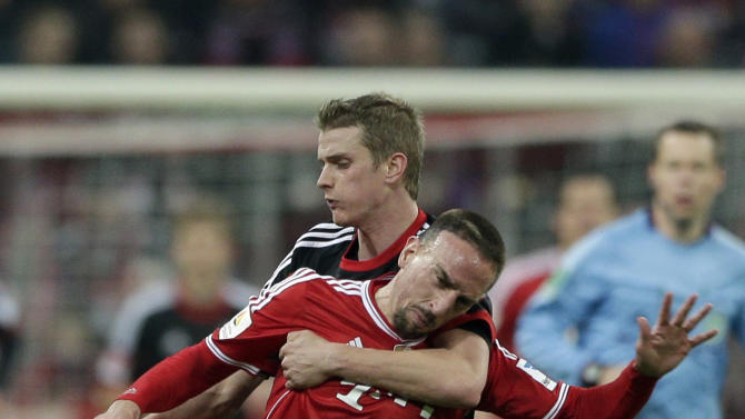 Bayern's Franck Ribery, front, and Leverkusen's Lars Bender challenge for the ball during the German first division Bundesliga soccer match between FC Bayern Munich and Bayer 04 Leverkusen, in Munich, southern Germany, Saturday, March 15, 2014