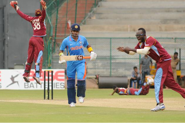West Indies A team players celebrates after the wicket of India A team, during  India A team v/s West Indies A team unofficial T-20 cricket match at Chinnaswamy Stadium, in Bangalore on Saturday 21st