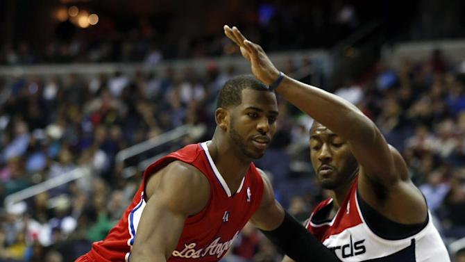 Los Angeles Clippers guard Chris Paul (3) drives against Washington Wizards guard John Wall (2) in the first half of an NBA basketball game, Saturday, Dec. 14, 2013, in Washington
