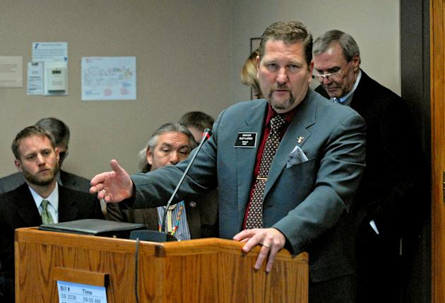Sen. Oley Larsen, R-Minot, speaks Wednesday morning, March 4, 2015, to members of the House Finance &Taxation Committee on SB 2165, a bill that would set up a study on whether to provide money to newb