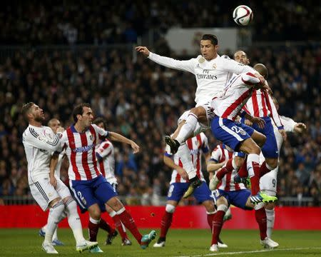 Real Madrid's Cristiano Ronaldo goes for a header with Atletico Madrid's Joao Miranda during their King's Cup round of 16 second leg soccer match in Madrid