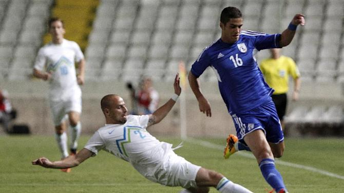 Cyprus' Petros Sotiriou, right, fights for the ball with Slovenia's Miso Brecko during their World Cup group E qualifying soccer match at GSP stadium in Nicosia, Cyprus, Tuesday, Sept. 10, 2013