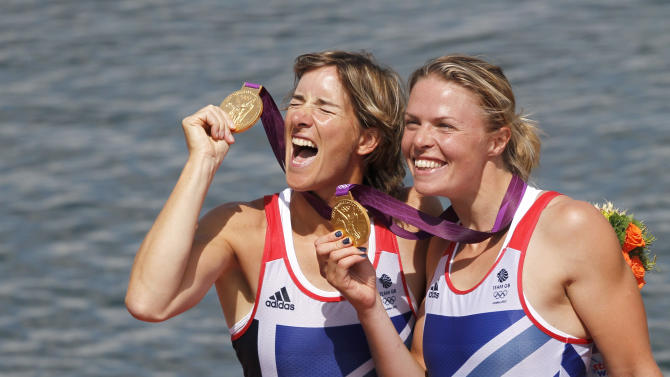 Gold medallists Britain's Katherine Grainger and Anna Watkins celebrate during awards ceremony for women's double sculls at London 2012 Olympic Games