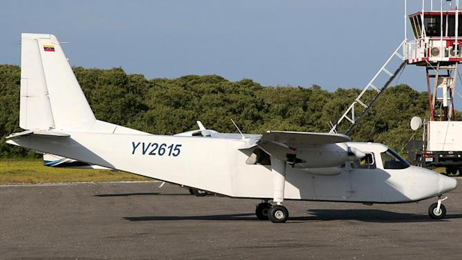 In this undated photo provided by Venezuela's Ministry of the Interior and Justice Press Office, a plane that went missing sits on the tarmac of the airport in Los Roques, Venezuela. Venezuela's Interior Minister Nestor Reverol said the plane was declared missing hours after taking off Friday, Jan. 5, 2013 from Los Roques, a string of islands, cays and islets that is popular for scuba diving, white beaches and coral reefs. He said the plane was expected at Simon Bolivar International Airport in Caracas but didn't arrive and that the four Italian tourists aboard had spent their Christmas and New Year at the resort. The plane had two Venezuelan crew members. (AP Photo/Ministry of the Interior and Justice Press Office)