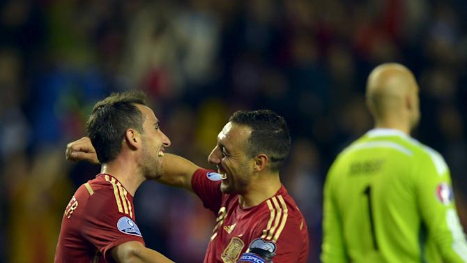 Spain's Paco Alcacer and Santi Cazorla celebrate a goal during their Euro 2016 Group C qualification soccer match against Luxembourg in Logrono