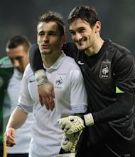 French captain Hugo Lloris (R) and defender Mathieu Debuchy react after the International friendly football match Germany vs France in the northern German city of Bremen. France won 2-1