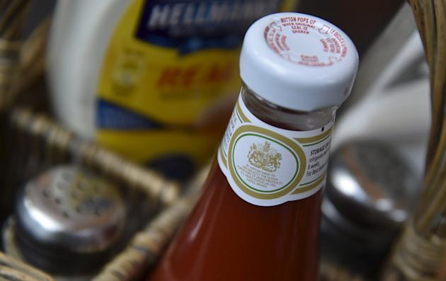 A royal warrant is seen printed on a bottle of tomato sauce, at a cafe in London