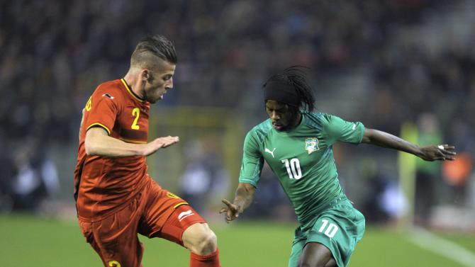 Belgium's Alderweireld tries to block Ivory Coast's Gervinho during their international friendly soccer match at King Baudouin Stadium in Brussels