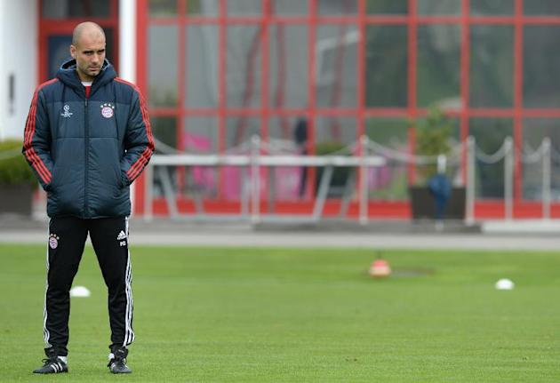 Bayern Munich's Spanish head coach Pep Guardiola follows the last team training session ahead the UEFA Champions League quarter-final second leg football match between Bayern Munich and Manchester