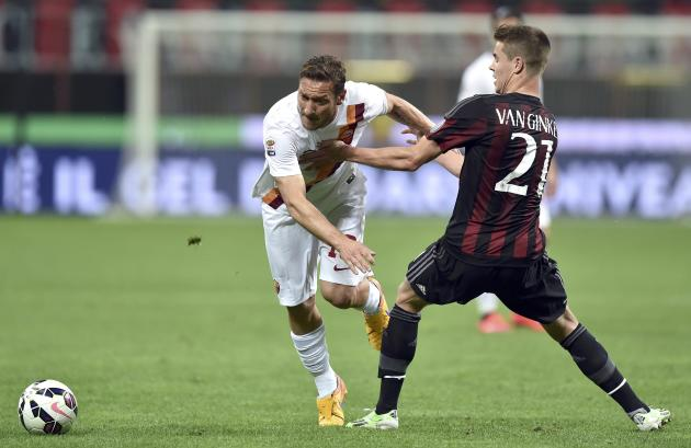AC Milan's van Ginkel challenges AS Roma's Totti during their Serie A soccer match at the San Siro stadium in Milan
