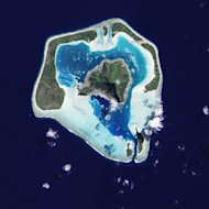A satellite image of Maupiti, one of the Society Islands, which is on its way to becoming an atoll. Submerged reef appears in pale blue.