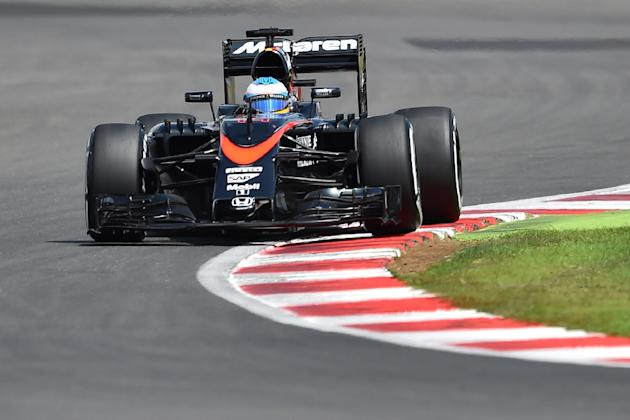 McLaren Honda's Spanish driver Fernando Alonso drives during the qualifying session at the Silverstone circuit in Silverstone on July 4, 2015 ahead of the British Formula One Grand Prix